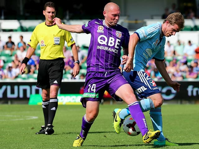 Sydney's Matthew Thompson and Perth Glory's Steven McGarry battle for the ball during their A League match on November 2, 2013