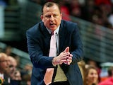 Head coach Tom Thibodeau of the Chicago Bulls gives encouragement to his team against the Denver Nuggets during a preseason game at the United Center on October 25, 2013