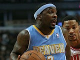 Ty Lawson of the Denver Nuggets in action against the Chicago Bulls during a preseason game at the United Center on October 25, 2013