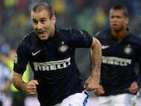Inter Milan's Argentinian forward Rodrigo Sebastian Palacio (L) celebrates after scoring during the Italian seria A football match Udineses vs Inter Milan, on November 3, 2013