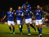 Wes Morgan of Leicester City is mobbed by team mates after scoring his goal during the Capital One Cup fourth round match against Fulham on October 29, 2013