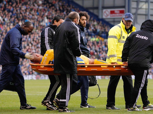 Adlene Guedioura of Crystal Palace is carried off injured during the Barclays Premier League match between West Bromwich Albion and Crystal Palace at The Hawthorns on November 2, 2013