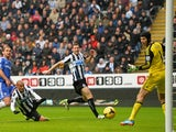 Newcastle's Yoan Gouffran heads the ball past Petr Cech to score the opening goal against Chelsea on November 2, 2013