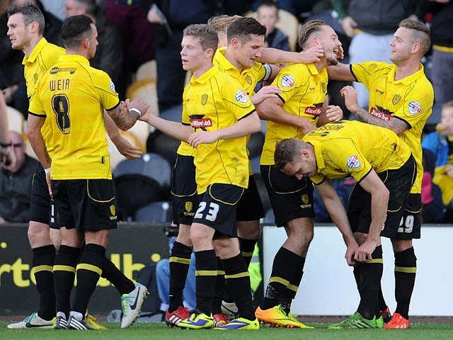 Burton's Adam McGurk is congratulated by teammates after scoring the opening goal against Hereford on November 10, 2013