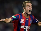 Adam Taggart of the Jets celebrates a goal during the round four A-League match between the Newcastle Jets and the Central Coast Mariners at Hunter Stadium on November 2, 2013