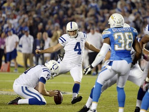 Adam Vinateri of the Indianapolis Colts kick a field goal against San Diego Chargers at Qualcomm Stadium October 14, 2013
