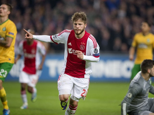 Ajax's Danish midfielder Lasse Schone celebrates scoring his team's first goal during the UEFA Champions League group H football match between Ajax Amsterdam and Celtic FC on November 6, 2013