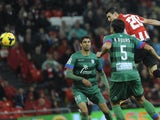 Athletic Bilbao's forward Aritz Aduriz heads the ball to score during the Spanish league football match Athletic Club Bilbao vs Levante at the San Mames stadium in Bilbao on November 9, 2013