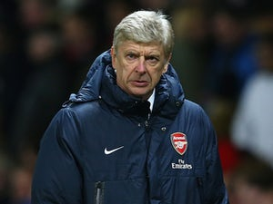Wenger relieved to get through