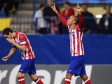 Atletico Madrid's Brazilian defender Joa Miranda de Souza celebrates after scoring during the the UEFA Champions League football match Club Atletico de Madrid vs Austria Wien on November 6, 2013