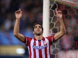 Atletico Madrid's midfielder Raul Garcia celebrates after scoring during the the UEFA Champions League football match Club Atletico de Madrid vs Austria Wien on November 6, 2013
