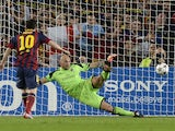 Barcelona's Argentinian forward Lionel Messi scores a penalty during the UEFA Champions league football match FC Barcelona vs AC Milan at the Camp Nou stadium in Barcelona on November 6, vies with 2013.