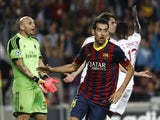 Barcelona's midfielder Sergio Busquets celebrates after scoring a goal during the UEFA Champions league football match FC Barcelona vs AC Milan at Camp Nou stadium in Barcelona on November 6, 2013