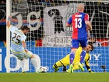 Steaua Bucharest's Italian forward Fiederico Piovaccari scores his team's first goal against FC Basel's goalkeeper Yann Sommer during an UEFA Champions League group E football match between FC Basel and Steaua Bucharest on November 6, 2013