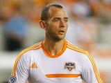 Brad Davis of the Houston Dynamo works out on the field before the game against the Chicago Fire at BBVA Compass Stadium on July 27, 2013