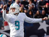 Caleb Sturgis of the Miami Dolphins watches his field goal in the 2nd quarter against the New England Patriots in the first half at Gillette Stadium on October 27, 2013