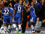 Samuel Eto'o of Chelsea celebrates with Jose Mourinho the Chelsea manager after scoring the opening goal during the UEFA Champions League Group E match between Chelsea and FC Schalke 04 at Stamford Bridge on November 6, 2013