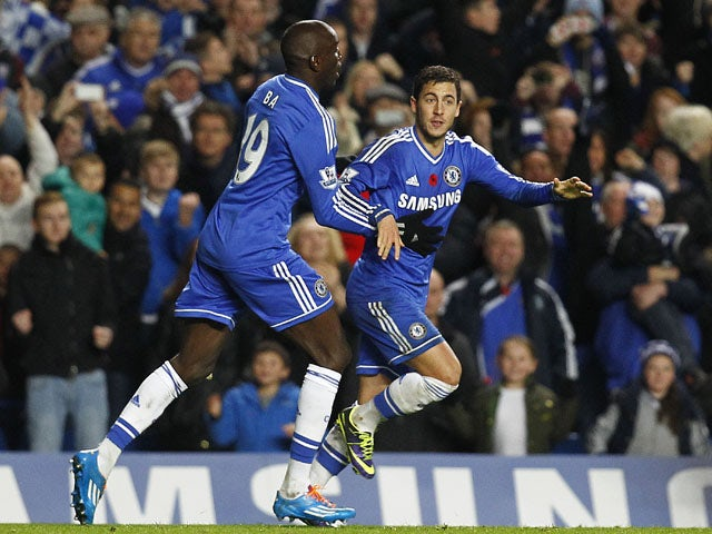 Eden Hazard of Chelsea celebrates with team mate Demba Ba after scoring the equaliser during the Barclays Premier League match between Chelsea and West Bromwich Albion at Stamford Bridge on November 09, 2013