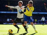 Tottenham Hotspur's Christian Eriksen and Davide Santon of Newcastle United battle for the ball at White Hart Lane on November 10, 2013