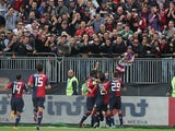 Cagliari's Daniele Conti celebrates with team mates and fans after scoring his second goal against Torino on November 10, 2013