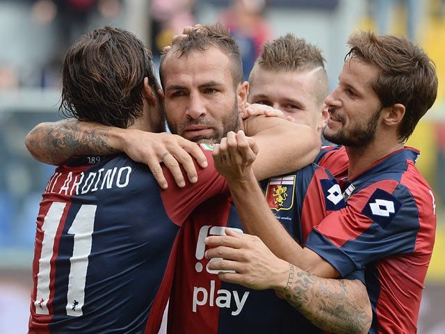 Genoa's Daniele Portanova is congratulated by teammates after scoring the opening goal against Hellas Verona on November 10, 2013