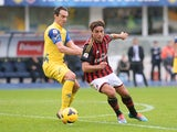 Chievo Verona's Dario Dainelli and AC Milan's Alessandro Matri battle for the ball on November 10, 2013