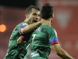 Levante's midfielder David Barral celebrates with teammate Levante's Austrian forward Andreas Ivanschitz during the La Liga match against Athletic Club Bilbao on November 9, 2013
