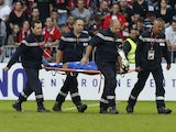 Nice's Columbian goalkeeper David Ospina is carried to leave the pitch after being injured during the French L1 football match against Bordeaux on November 3, 2013