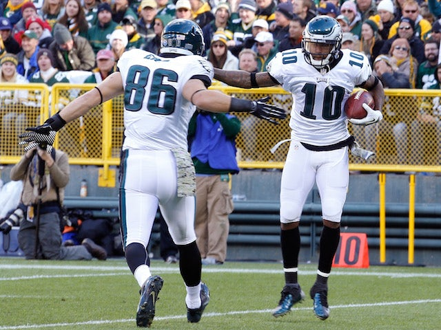 DeSean Jackson of the Philadelphia Eagles celebrates a first quarter touchdown with Brandon Bostick while playing the Green Bay Packers at Lambeau Field on November 10, 2013
