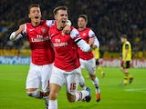 Arsenal's Welsh midfielder Aaron Ramsey celebrates scoring the opening goal with Arsenal's German midfielder Mesut Ozil during the UEFA Champions League group F football match Borussia Dortmund vs Arsenal London in Dortmund, western Germany on November 6,
