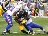 Emmanuel Sanders of the Pittsburgh Steelers is tackled by Jairus Byrd of the Buffalo Bills during the game on November 10, 2013