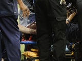 Houston Texans head coach Gary Kubiak is loaded on a stretcher after he collapsed on the field as the team left for halftime against the Indianapolis Colts at Reliant Stadium on November 3, 2013
