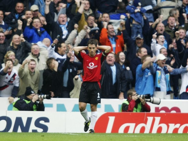 Gary Neville reacts to his mistake that allows Shaun Goater to score for Manchester City on November 09, 2002.