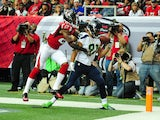Golden Tate of the Seattle Seahawks hauls in a touchdown pass against Robert Alford of the Atlanta Falcons at the Georgia Dome on November 10, 2013