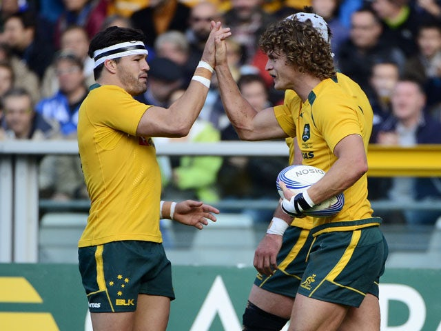 Australias's winger Nick Cummins celebrates his 2nd try during the rugby test match between Italy and Australia on November 9, 2013