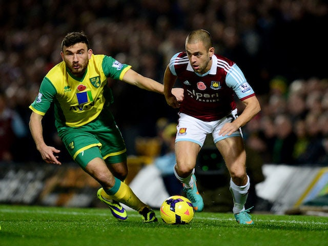 Joe Cole of West Ham United takes on Robert Snodgrass of Norwich City during the Barclays Premier League match between Norwich City and West Ham United on November 9, 2013