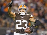 Cornerback Joe Haden of the Cleveland Browns celebrates after catching and interception during the first half against the Baltimore Ravens at FirstEnergy Stadium on November 3, 2013