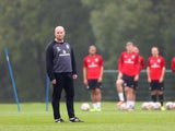 John Hartson assistant coach looks on during the Wales training session at the Vale of Glamorgan complex on October 8, 2013