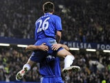 Chelsea's captain John Terry jumps into the arms of team-mate Frank Lampard after scoring during the English Premier League footbal match between Chelsea and Manchester United on November 8, 2009