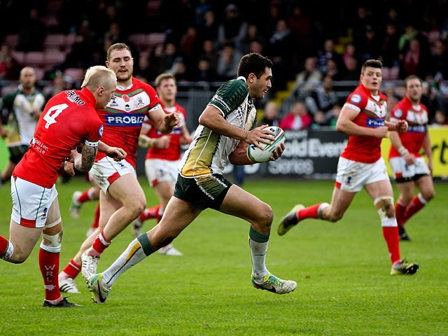 Cook Islands' Jonathon Ford breaks away to score a try against Wales during their World Cup Group D match on November 10, 2013