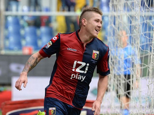 Genoa's Juraj Kucka celebrates after scoring his team's second goal against Hellas Verona on November 10, 2013