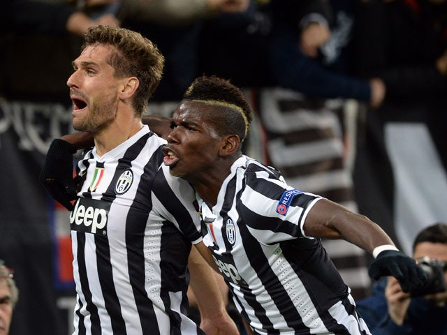 Fernando Llorente of Juventus celebrates his goal with team-mate Paul Pogba during the UEFA Champions League Group B match between Juventus and Real Madrid at Juventus Arena on November 5, 2013