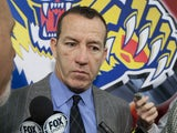 Head coach Kevin Dineen of the Florida Panthers talks to the media following their 4-0 loss against the Ottawa Senators at Scotiabank Place on January 21, 2013