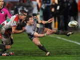 Connacht's scrum-half Kieran Marmion is tackled by Biarritz's french number eight Imanol Harinordoquy during the European Cup rugby union match Biarritz Olympique versus Connacht at the Aguilera stadium in Biarritz, southwestern France on December 14, 201