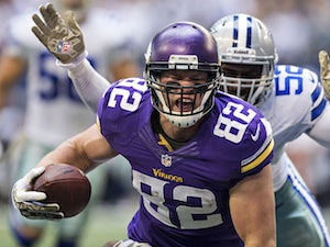 Kyle Rudolph #82 of the Minnesota Vikings scores a touchdown against the Dallas Cowboys at AT&T Stadium on November 3, 2013