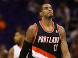 LaMarcus Aldridge #12 of the Portland Trail Blazers reacts during the final moments of the opening night NBA game against the Phoenix Suns at US Airways Center on October 30, 2013