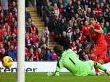 Luis Suarez of Liverpool scores the third goal during the Barclays Premier League match between Liverpool and Fulham at Anfield on November 9, 2013