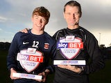 Hartlepool's Luke James with his boss Colin Cooper and his Player of the Month award for October on November 7, 2013