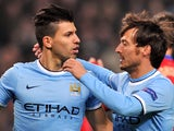 Manchester City's Argentinian striker Sergio Aguero celebrates scoring from a penalty with teammate Spanish midfielder David Silva during the UEFA Champions League football match between Manchester City and CSKA Moscow at The Etihad Stadium in Manchester,