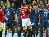 Manchester United and Arsenal players clash during a match at Old Trafford on October 24, 2004.
